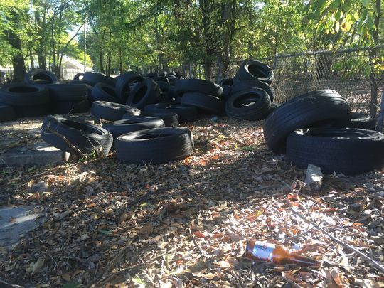 tyres dumped illegally next to residential homes