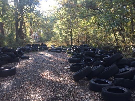 sumped tyres among forest path